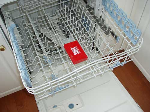 Put the wax brush in the top rack of your dishwasher