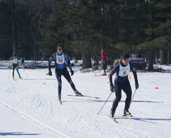 Susan Vigland beats Catarina Gulledge to the finish in the A Final of the Michigan Cup Sprints cross county ski race