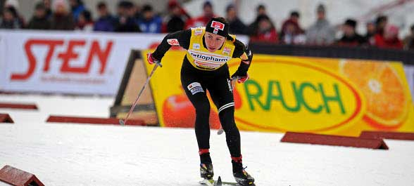 Justyna Kowalczyk claimed victory in the classical 15 km Mass start