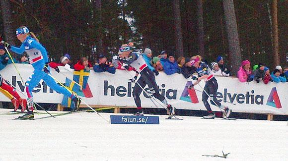 Jessie Diggins chases Kikkan Randall during the women's 10k mass start in Falun. (USSA-Margo Christiansen)