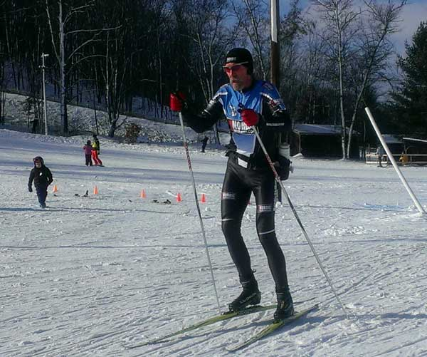 "Bill Kaltz of the Team NordicSkiRacer Team ""The Snow Surfers"" on his way out on a lap."