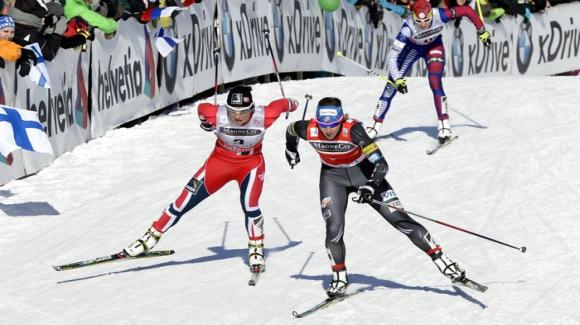 In the second stage of the mini-tour on Friday, Kikkan Randall skied into third place, leading three Americans into the top eight in Falun, Sweden. Here she is (right) racing in Lahti, Finland. (Getty Images/AFP/Heikki Saukkomaa)