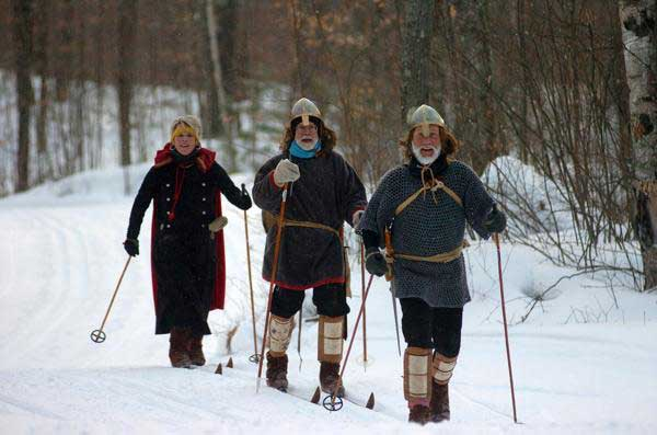 Three cross country skiers depict the two Birkebeiner Warriors and Inga, the mother of baby Prince Haakon, at the annual American Birkebeiner ski race
