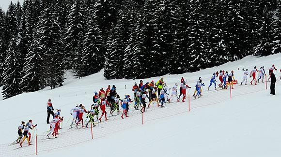 Skiers charge up a hill in the women's 10k mass start in La Clusaz. (Getty Images/Agence Zoom-Alain Grosclaude)