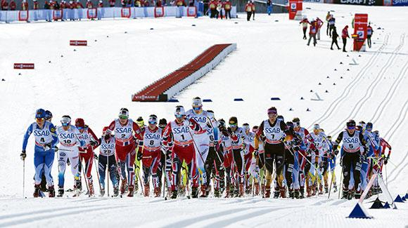 Women head out at the start of the skiathlon skiing 7.5k classic before switching skis to freestyle. (Getty Images/AFP-Jonathan Nackstrand)
