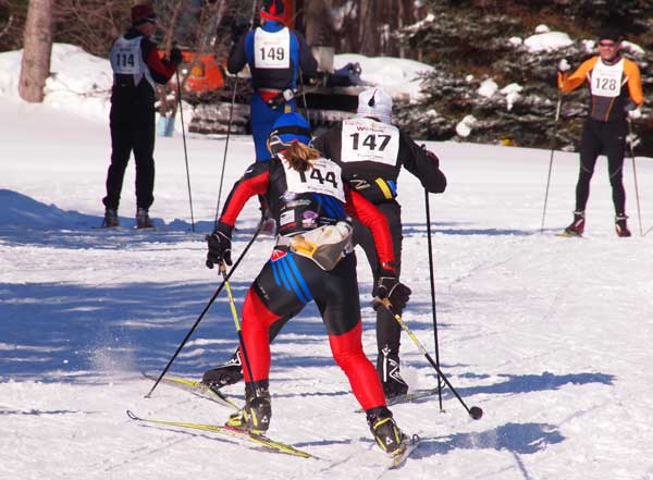 Laura Webb beats Susan Vigland for 2nd place at the finish of the Forbush Corner 17K cross country ski race