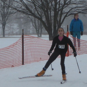 Rylee Raye Robinson crossing the finish line at the Frosty Freestyle xc ski race