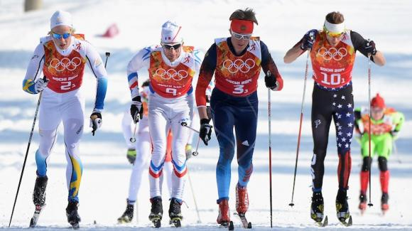 Andy Newell (right) kicks off the men's relay, where Team USA came up from the back of the pack Sunday to finish 11th. (Getty Images/Harry How)