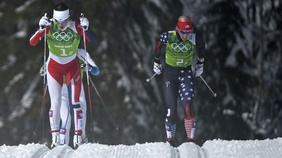 Kikkan Randall, seen here with Norway's Marit Bjoergen at the 2014 Sochi Olympic Winter Games, skied to a career-best 12th in the 30k classic World Cup at Holmenkollen Sunday. (Getty Images/AFP/Pierre-Philippe Marcou)