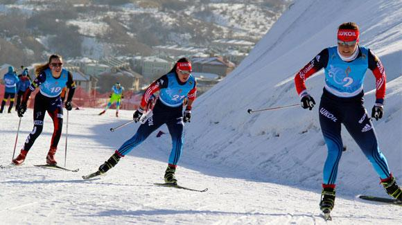 Katherine Ogden (left) skis to a 6th place finish in the 5/5K skiathalon at the 2015 Nordic Junior World Championships.
