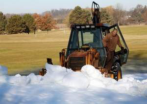 Plow snow onto cross country ski trails at Huron Meadows Metropark