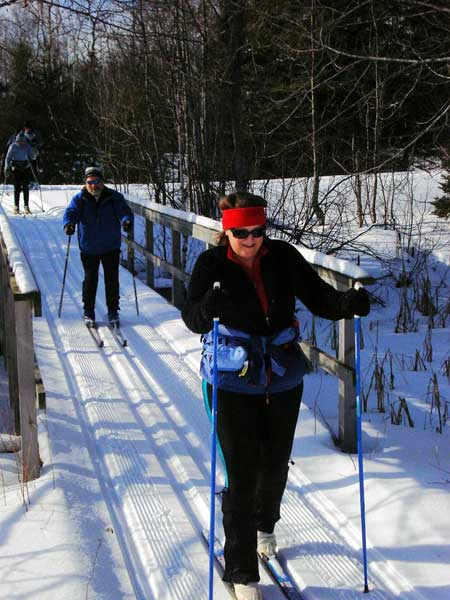 Cross country skiing over a wildernes bridge