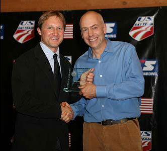 USSA Development Coach of the Year Bryan Fish receives his award from USSA Chairman of the Board, Dexter Paine (credit: Scott Sine)