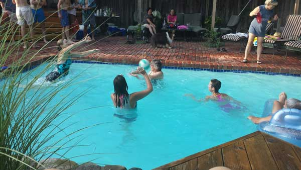 Nordic Ski Racers playing volleyball in the pool