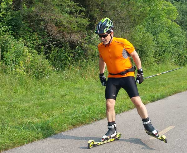 Tony Percha out early on the 4th of July getting in a long slow distance session (LSD) at L1 (60-70% of max hart rate). This picture is from the bike path that connects Kensigton Metropark with the city of Milford. (Photo: Mike Muha)