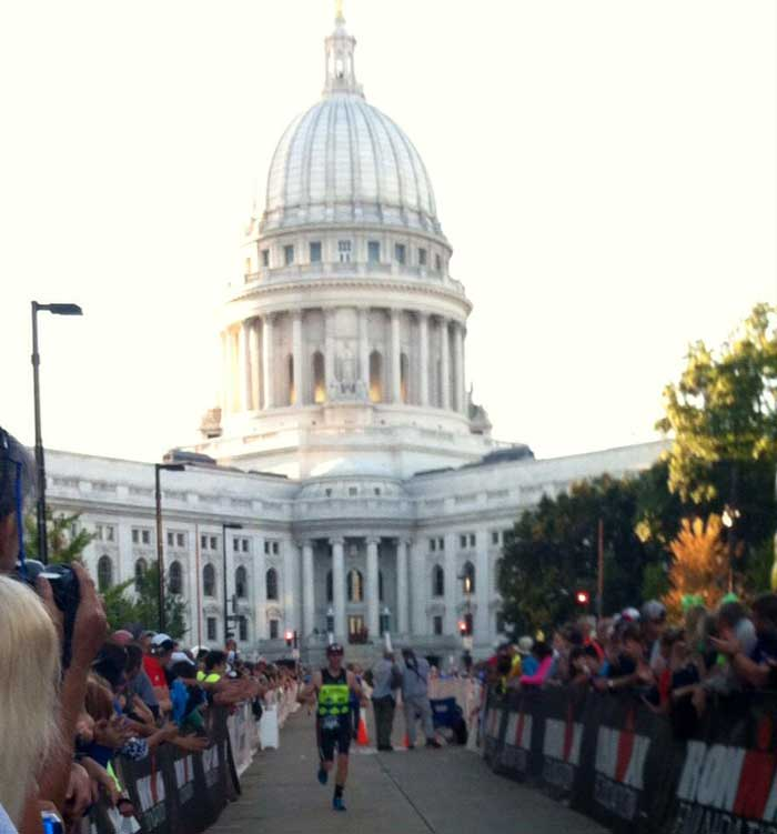 Jay Woodbeck of Team NordicSkiRacer finishes the Wisconson Ironman. Teammates Adam Haberkorn and Rex Blair finish the hilly course a little later.
