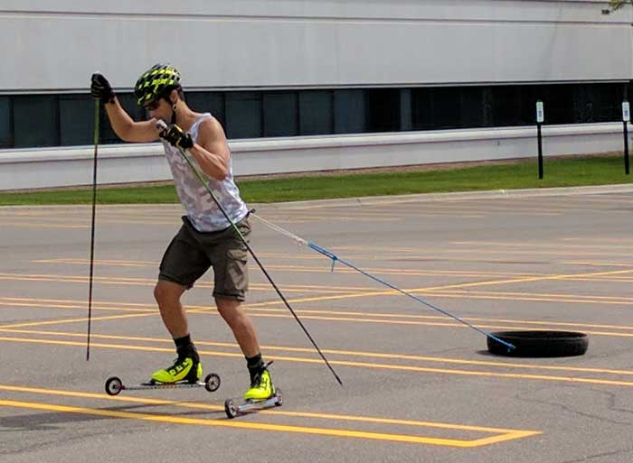 Team NordicSkiRacer&#39s Ricardo Lung learning to lean forward at the ankles by dragging a tire behind him. The things you learn at one of Andy Liebner's rollerski clinics!
