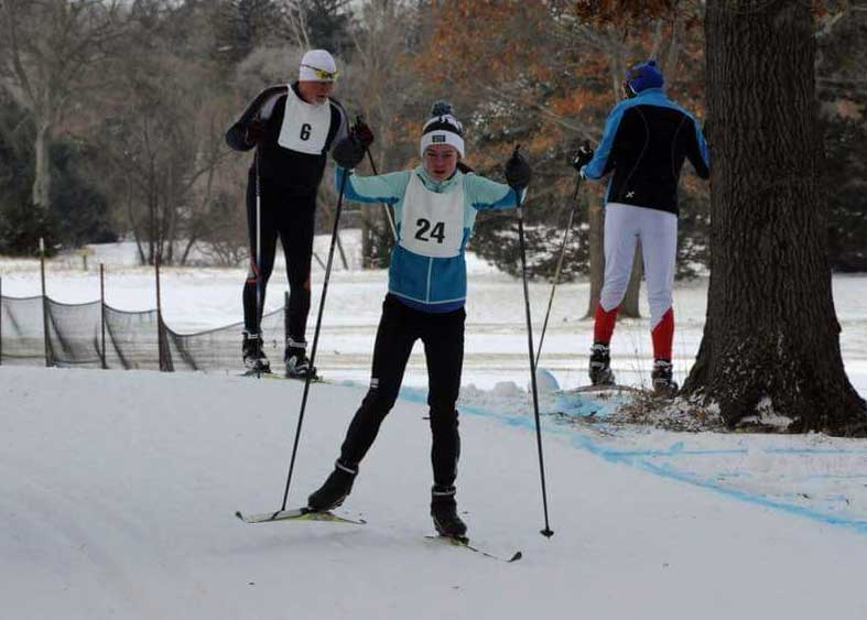 Abby Olson (24) on her way to third-place overall in the Frosty Freestyle 5K (Photo: Greg Sadler Photography. More photos at http://www.backprint.com/gregsadlerphotography)