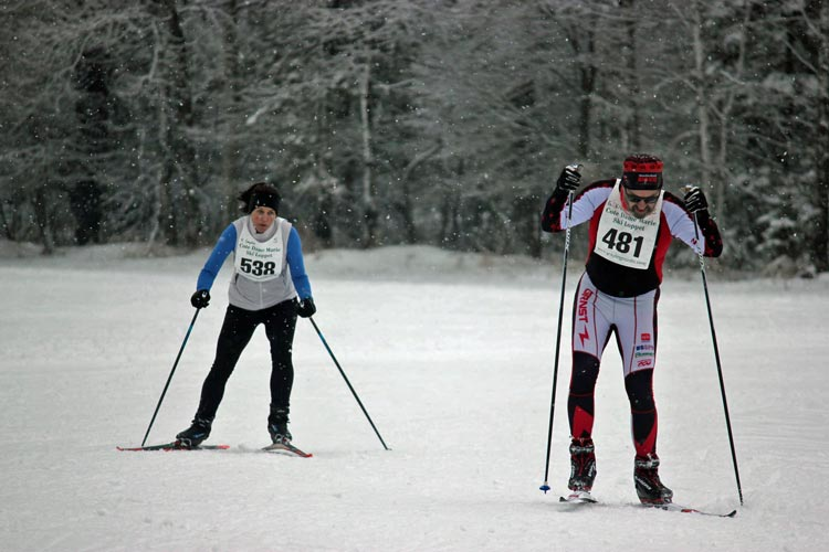 Hanson Hills / Cross Country Ski Shop's Heather Compton and Grand Rapids Nordic's Gregory Kil head to the finish line at this Saturday's Cote Dame Marie.
