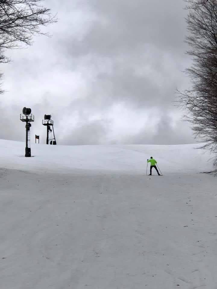 "And you thought skiing was done in the Lower Peninsula! John Gravlin (pictured) and Tracy Paul-Hardin Gravlin found tons of snow on the front downhills at Nubs Nob in Harbor Springs. Of course it was ""one incredible looping climb to the top of Nubs"" and Tracy didn't mind stopping to take a picture!"