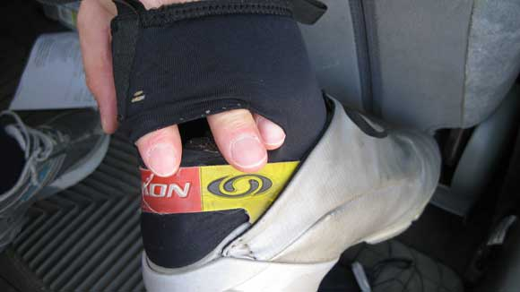 Salomon ski boot with a big hole in it