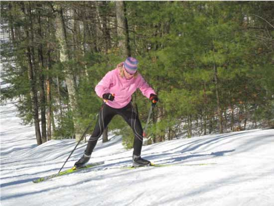 Fran Upton cross country skis up The Wall on the Vasa Trail