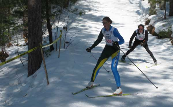 Ann Wagar negotiates the last fast downhill corner at the  2010 Black Mountain Classic cross country ski race