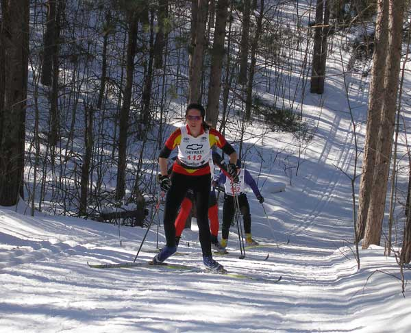 Catarina Gulledge climbs the last big hill at the  2010 Black Mountain Classic cross country ski race