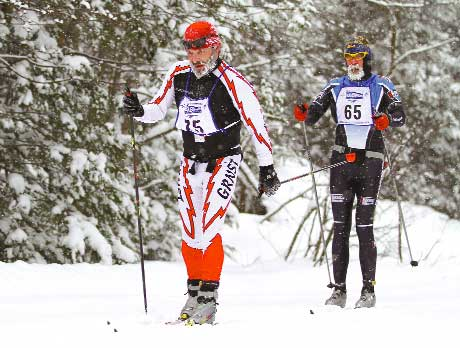 Michael Seaman and Bill Kaltz near the half way point of the 51 kilometer classic with frozen beards during the Noquemanon Ski Marathon