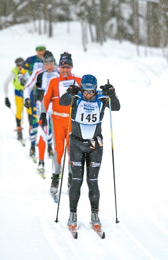 Ken Dawson leads a pack of skiers at the midpoint of the 51-kilometer Classic race during the Noquemanon Ski Marathon