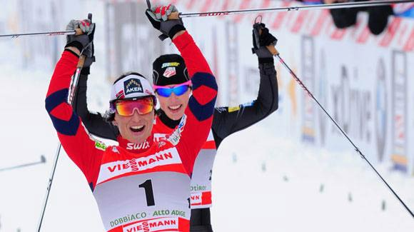 Two champions of the sport cross the finish line in celebration as Norway's Marit Bjoergen takes a strategic win followed closely by Kikkan Randall, who moved up to fourth in the Tour de Ski. (Getty Images/AFP)