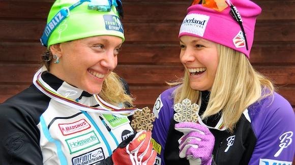 Caitlin Gregg and Jessie Diggins smile at their World Championships medals in 2015. (USSA)