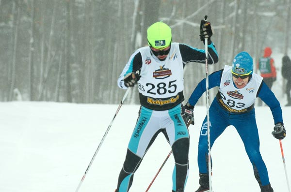 Caitlin Gregg (Team Gregg) and Rosie Brennan (APU) battle the cold and blowing conditions at the U.S. Cross Country Championships.