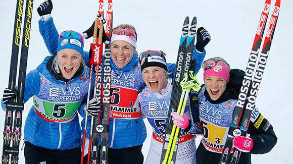 Sadie Bjornsen, Rosie Brennan, Jessie Diggins and Liz Stephen celebrate in the finish after taking third in Lillehammer. (Getty Images/AFP-Cornelius Poppe)