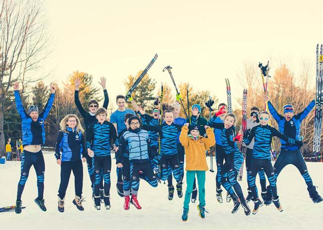 Copper Country Ski Tigers celebrate vctory in Michigan HS XC Ski Championships