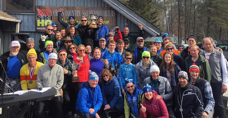 Cross Country Ski Headquarters ski team shows off the Michigan Cup and Brumbaugh Cup