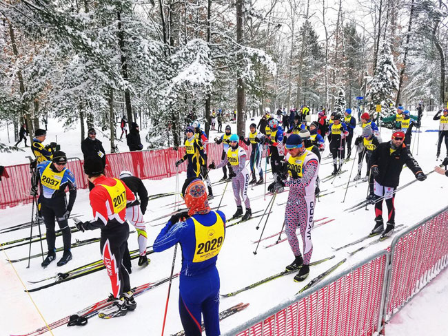 Skiers lined up on the tart line of the North American Vasa cross country ski race