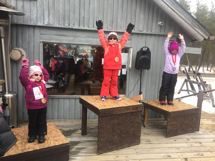 Three kids on the podium at the 2021 Muffin Race cross country ski race