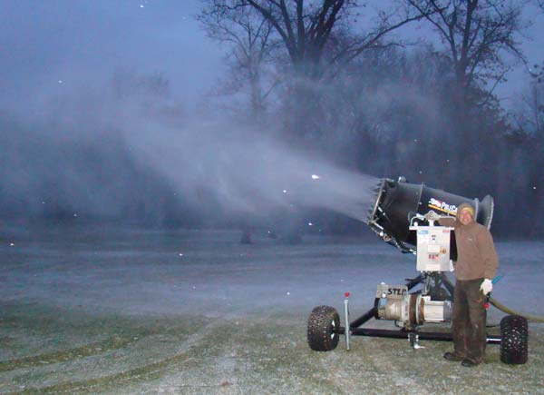 Adam Haberkorn fires up the snow making gun for the first time on Monday night, Jan 2, 2012