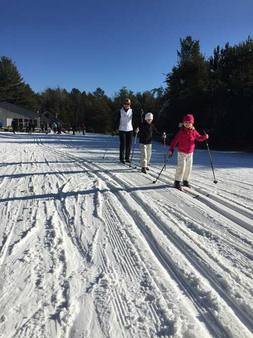 Mom and kids cross country skiing at Cross Country Ski Headquarters